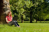 Woman working or studying in a park — Stock Photo