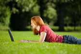 Woman with computer in a park — Stock Photo