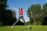 A free woman jumping — Stock Photo