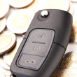 Car key and money - car costs concept — Stock Photo