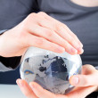 Hands holding a glass globe — Stockfoto