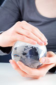 Hands holding a glass globe — Stock Photo