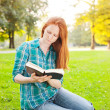 A Student Reading a Book in a Park — Stock Photo