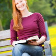 Stock Photo: A Happy Woman with a Book