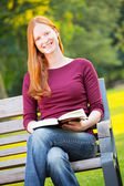A Happy Woman with a Book — Stock Photo