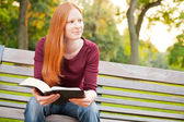A Woman Meditating on the Bible in a Park — Stock Photo