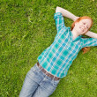 Carefree Woman Lying on a Green Field — Stock Photo