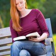 A Woman Reading a Book in a Park — Stock Photo