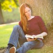 Reading a Book on Campus — Stock Photo