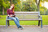 Studying the Bible in a Park — Stock Photo