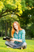 A Woman Doing Bible Study in a Park — Stock Photo