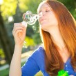 Young Woman Making Bubbles — Stock Photo