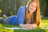 Happy Young Student Studying in a Park — Stock Photo