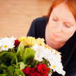 Woman Smelling a Bouquet of Flowers — Stock Photo