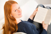 Student Reading a Book at Home — Stock Photo