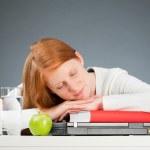 College Student Sleeping on Her Desk — Stock Photo