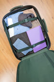 Trip and Travel - Suitcase with Clothes — Stock Photo