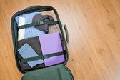 Open Suitcase Lying on the Floor — Stock Photo