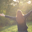 Rejoice in Nature - Woman in a Park — Stock Photo #35498889