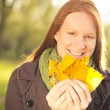 Woman with Yellow Leaves in Autumn — Stock Photo #35499007