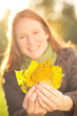 Woman Holding Fall Leaves — Stock Photo