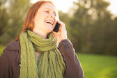Woman on the Phone in a Park — Stock Photo