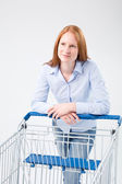 Young Woman with Supermarket Cart — Stock Photo