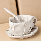 Coffee Cup Wrapped in Paper — Stock Photo