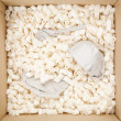 Stock Photo: Wrapped Dishware in Box with Filler