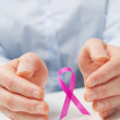 Hands and a Pink Ribbon — Foto Stock #46002267