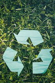 Recycling Symbol on Green Grass — Stock Photo