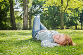 Woman Takes a Nap in a Park — Stock Photo