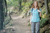 Woman Hiking in a Forest — Foto Stock