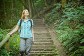Active Woman Explores a Forest — Foto Stock
