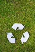 Recycling Sign on Grass — Stock Photo