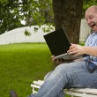 Happy Man Working in a Park — Stock Photo