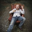 Thoughtful Man Drinking Cognac in a Vintage Chair — Stock Photo