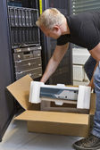 IT Engineer Unboxing New Router — Stock Photo