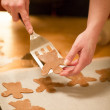 Woman bake Gingerbread Angels — Stock Photo