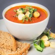 A bowl with Tomato Soup with Croutons and Herbs — Stock Photo