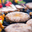 Barbecue with hamburgers and skewers — Stock Photo #28029285