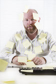 Exhausted Office Worker with Notes Everywhere — Stock Photo