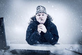 Businessman in a Cold Office with Snow and Ice — Stock Photo