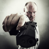 Man with a Gun — Stock Photo