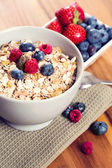 A bowl of muesli with fresh berries — Stock Photo