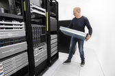 It consultant install rack server in datacenter — Stock Photo