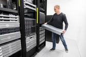 Woring IT consultant install rack server — Stock Photo