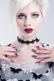 Young model with nail design — Stock Photo