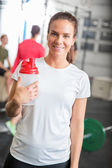 Woman at crossfit center taking a break — Stock Photo