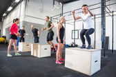 Crossfit group trains box jumps — Stock Photo